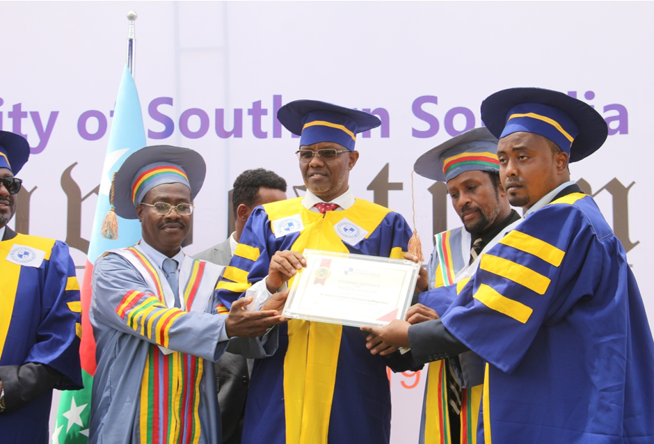 USS Chair & members of senior faculty conferring an Honorary Certificate in Political Leadership on President Abdiaziz Hassan Mohamed 'Laftagareen'