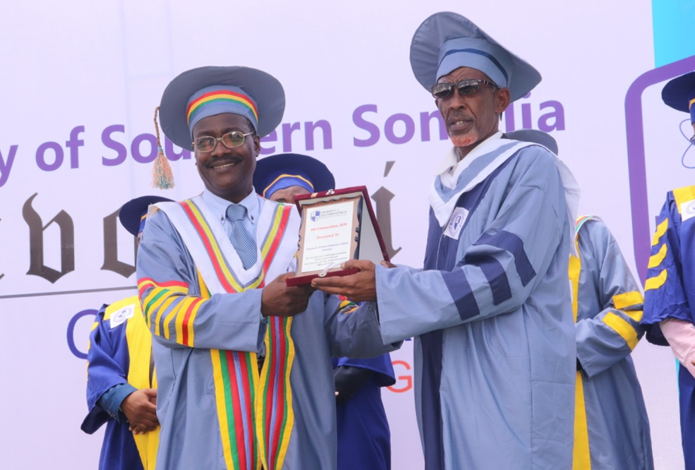 Prof. M. Eno awards a Certificate of Appreciation to Mr. Ahmed Abdirahman Adan (Anza)